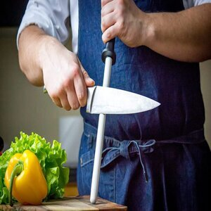 sharpen a serrated knife by a Ceramic Sharpening Rod