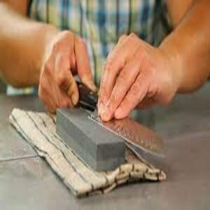 sharpen a serrated knife with a square stone