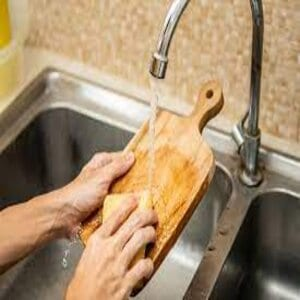 Cleaning your wooden cutting board with some water and soap