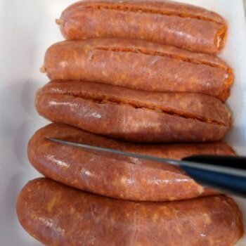 Use a Paring knife for Decasing Sausage.
